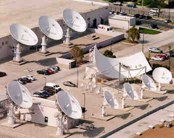 DBS DirecTV broadcast site, California, using RSI 9m and 11m antennas.  Each antenna uplink uses Tallguide TG87.